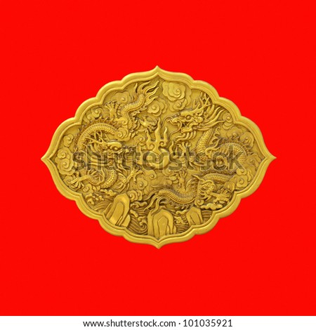 golden dragon wood carved on red wall