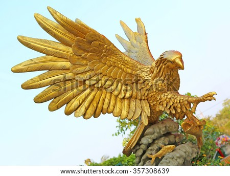 golden eagle statue against blue sky - stock photo