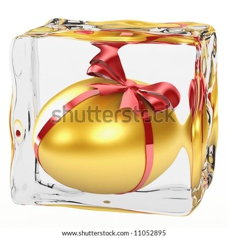 Golden Egg frozen in ice - stock photo