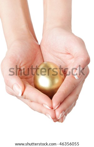 golden egg in the hands - stock photo