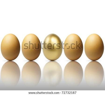 Golden egg isolated on white - stock photo