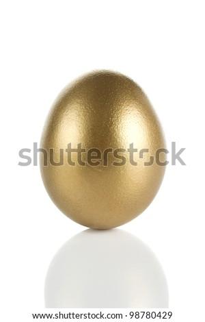 Golden egg isolated on white background - stock photo