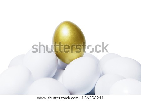 Golden egg standing out in the crowds - stock photo