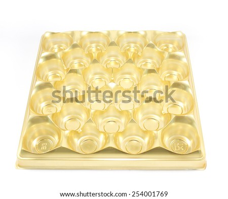 Golden egg tray isolated on white - stock photo
