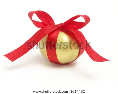 Golden egg wrapped around with red ribbon over white background
