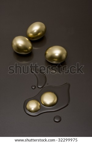 Golden eggs with a reflection on a black background - stock photo