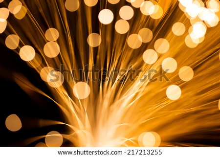 Golden fibre optic strands - stock photo