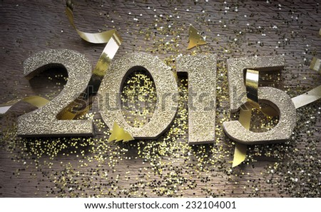 golden 2015 figures on wooden plank with glitters - stock photo