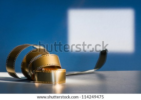 Golden film on the background of screen - stock photo