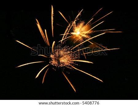 Golden firework explosions - stock photo