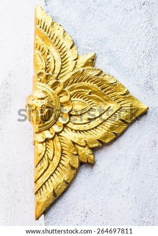 Golden flower stucco in the traditional Thai style. - stock photo