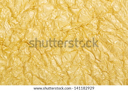 Golden foil crumpled background texture - stock photo