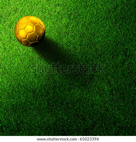 Golden football on grass field