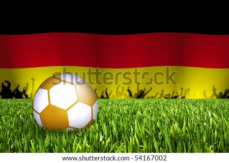 golden football with germany flag in back