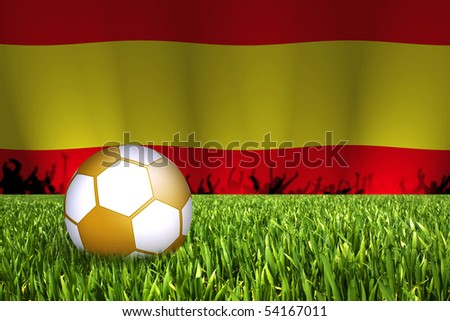 golden football with spain flag in back