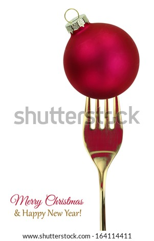 Golden fork with Christmas ball isolated on white background - stock photo