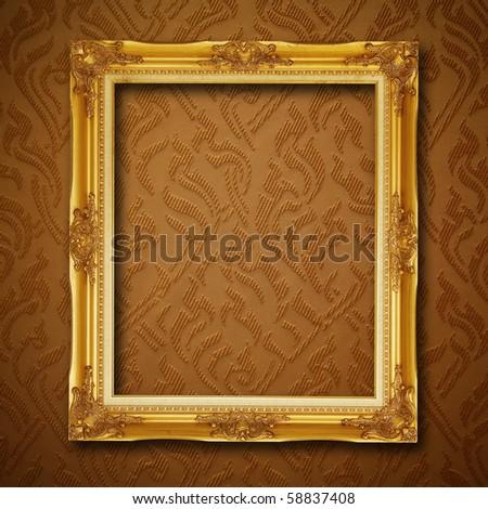 golden frame on vintage wallpaper - stock photo