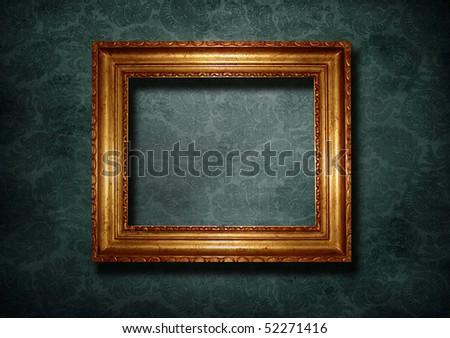 Golden frame over gray vintage wallpaper - stock photo