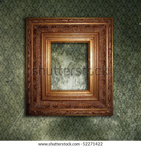 Golden frame over grunge green wallpaper - stock photo