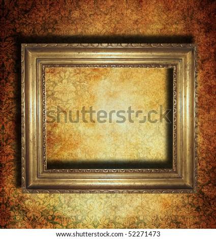 Golden frame over grunge wallpaper - stock photo