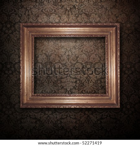 Golden frame over vintage wallpaper