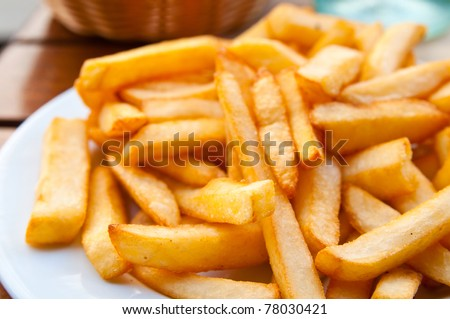 Golden French fries potatoes ready to be eaten - stock photo