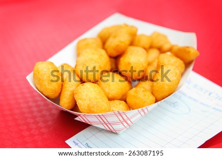Golden fried cheese curds. Shallow focus. - stock photo