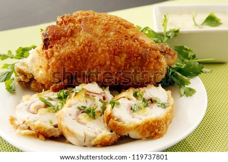 Golden fried chicken sliced with vegetable  garnishing - stock photo