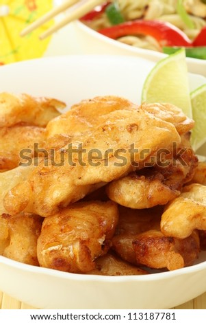 Golden fried fish sticks with vegetables and lime