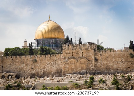 Golden gate at the old city of Jerusalem with El Aqsa mosque on the background - stock photo