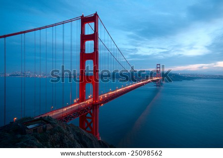 Golden Gate Bridge and an old ruin shot in dusk from a hill under Battery Spencer with San Francisco skyline in the background. - stock photo