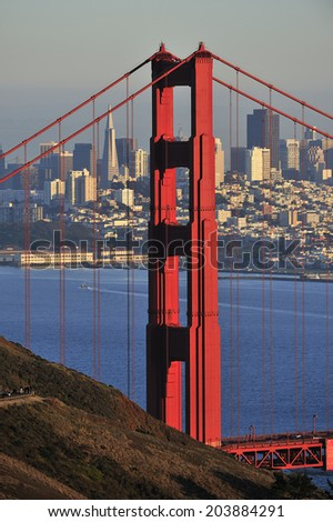Golden Gate Bridge and downtown in San Francisco, California, USA - stock photo