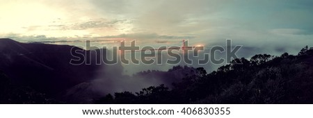 Golden Gate Bridge and fog panorama in San Francisco viewed from mountain top - stock photo
