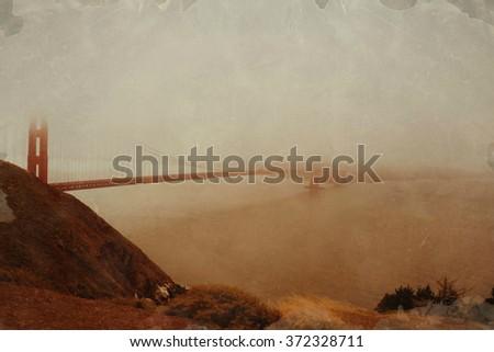Golden Gate Bridge and fog, San Francisco panoramic view, California, vintage postcard version - stock photo