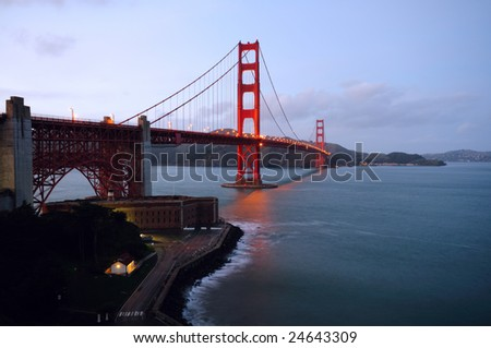 Golden Gate Bridge and Fort Point in the early dusk on a spring morning. Landscape (horizontal) orientation. - stock photo