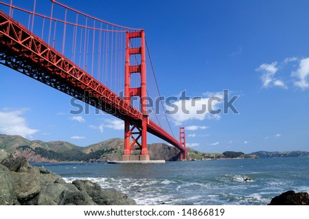 Golden Gate Bridge and rocks as seen from Fort Point, San Francisco, California. - stock photo