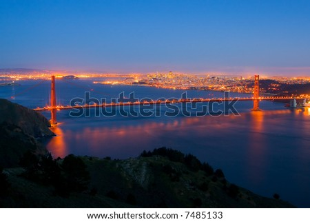 Golden Gate Bridge and San Francisco at night - stock photo