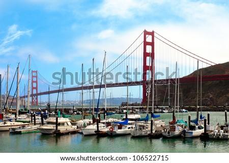 Golden Gate Bridge and the Presidio Yacht Harbor in San Francisco, California - stock photo