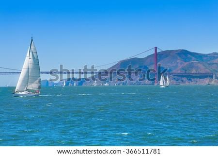 Golden gate bridge and yachts - stock photo