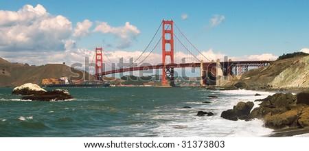 Golden Gate Bridge as seen from Baker Beach. - stock photo