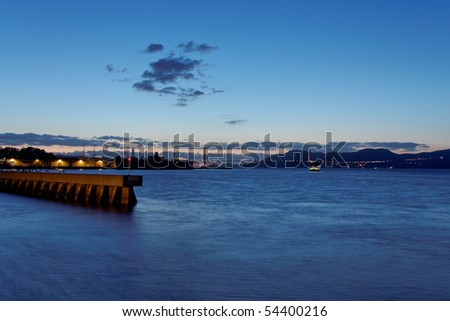 Golden gate bridge as seen from Pier 39 in San Francisco - stock photo
