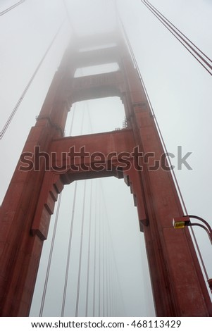 Golden Gate bridge as seen from the road on a foggy day, San Francisco, California