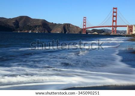 Golden Gate Bridge at Daylight Scene from Baker Beach - stock photo