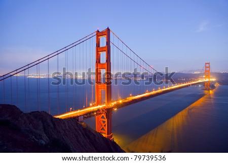 Golden Gate Bridge at Night with San Francisco Skyline, long exposure - stock photo