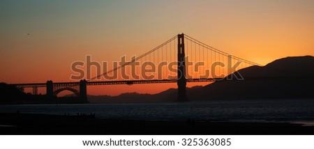 Golden Gate bridge at sunrise - stock photo