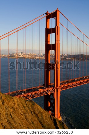 Golden Gate Bridge at sunset with San Francisco in the back - stock photo
