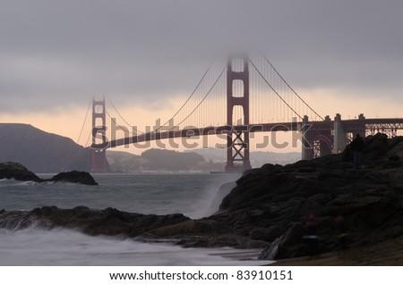 Golden Gate Bridge at twilight as seen from Baker Beach - stock photo