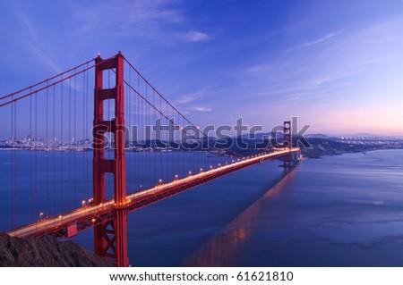 Golden gate bridge at twilight with beautiful light trail - stock photo