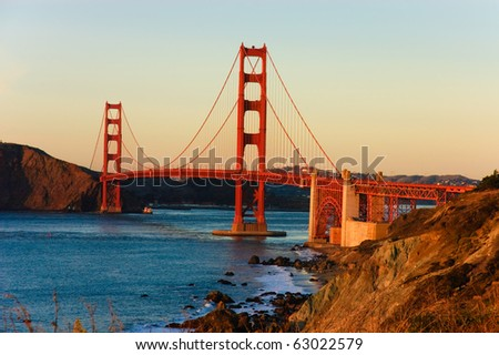 Golden gate bridge from Baker beach at sunset - stock photo