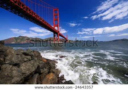 Golden Gate Bridge from Fort Point shot with a very wide angle lens on a wonderful spring morning. - stock photo